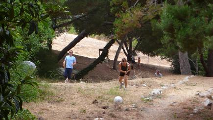 Elisa Liehr and Julian deCiutiis progress up the canyon as Danny Spielman works on getting his ball out of a tall tree.