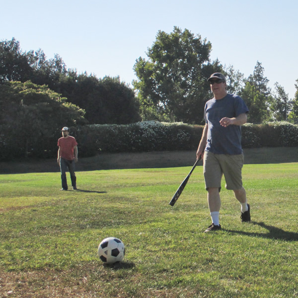 Steven Spielman races to his ball.